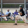 Jen Forbus - The Morning Journal<br /> Comet Luke Feakins takes one for the team when he's hit by a pitch.