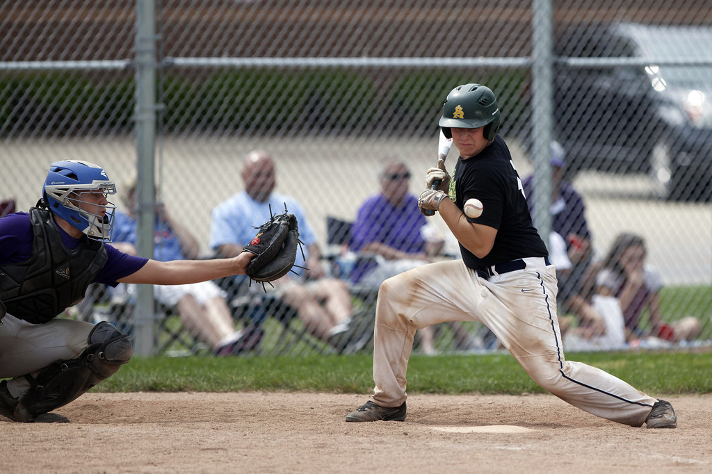 . Jen Forbus - The Morning Journal Comet Luke Feakins takes one for the team when he\'s hit by a pitch.
