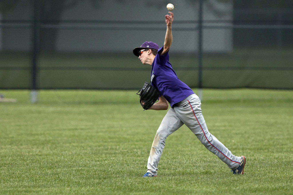 . Jen Forbus - The Morning Journal Keystone center fielder Nate Archer whips the ball back from the outfield.