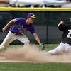 Jen Forbus - The Morning Journal<br /> Amherst's Kyle Dalzell slides into third base under Keystone third baseman Mikey Meleski's tag.