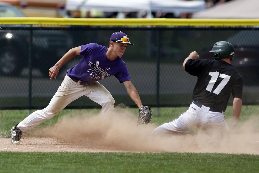 . Jen Forbus - The Morning Journal Amherst\'s Kyle Dalzell slides into third base under Keystone third baseman Mikey Meleski\'s tag.