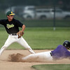 Jen Forbus - The Morning Journal<br /> After stepping on the bag, Amherst second baseman Dylan Bailey turns to fire the ball to first, trying for a double play.