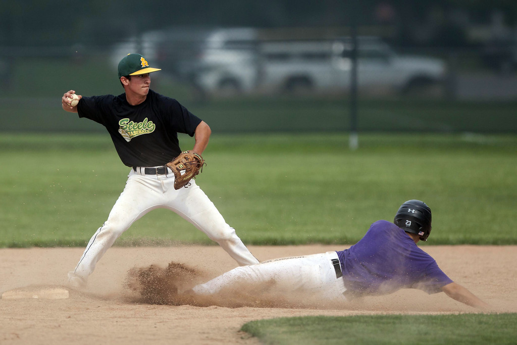 . Jen Forbus - The Morning Journal After stepping on the bag, Amherst second baseman Dylan Bailey turns to fire the ball to first, trying for a double play.