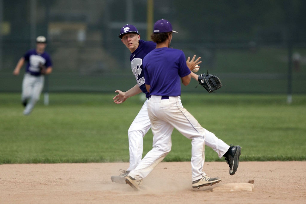 . Jen Forbus - The Morning Journal Keystone second baseman Matt Mealwitz makes the play at second and tosses the ball to short stop Cameron Emerick who makes the throw to first in time for the second out.