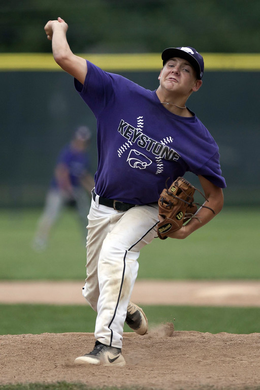 . Jen Forbus - The Morning Journal Wildcat pitcher Sean Saterlee delivers a pitch from the mound.