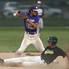 Jen Forbus - The Morning Journal<br />  Keystone short stop Cameron Emerick takes aim to throw the ball to first as Amherst's Jason Monos slides into second.