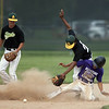 Jen Forbus - The Morning Journal<br /> Amherst short stop Josh Qualls falls over Keystone baserunner Cameron Emerick trying to maintain control of the baseball.