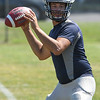 Eric Bonzar—The Morning Journal<br> Quarterback Justin Sturgill works on his passing routes, during the Lorain Titans' first day of practice, July 31, 2017.
