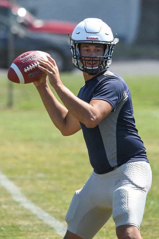 . Eric Bonzar�The Morning Journal<br> Quarterback Justin Sturgill works on his passing routes, during the Lorain Titans\' first day of practice, July 31, 2017.