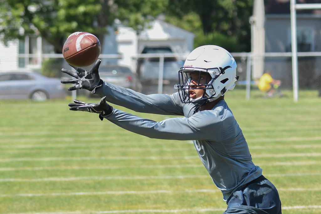 . Eric Bonzar�The Morning Journal<br> Titans running back Zion Cross runs short passing routes during the first day of practice, July 31, 2017.