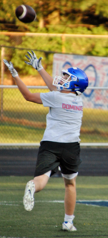. Jon Behm - The Morning Journal<br> Bay junior wide receiver Ross Beverly tracks down a pass during practice on July 31.