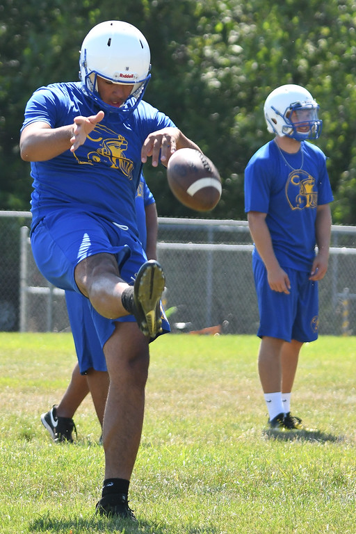 . Eric Bonzar�The Morning Journal<br> Clippers\' senior quarterback Anthony Terry works on his punting, during the first day of practice, July 31, 2017.
