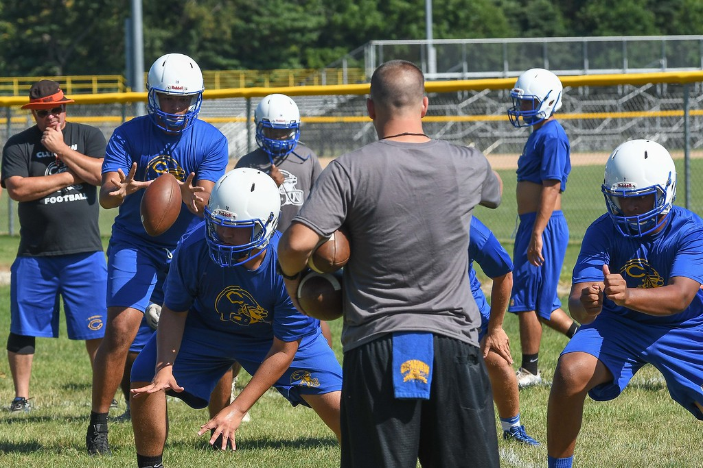 . Eric Bonzar�The Morning Journal<br> Clippers\' senior quarterback Anthony Terry handles a snap, during the first day of practice, July 31, 2017.