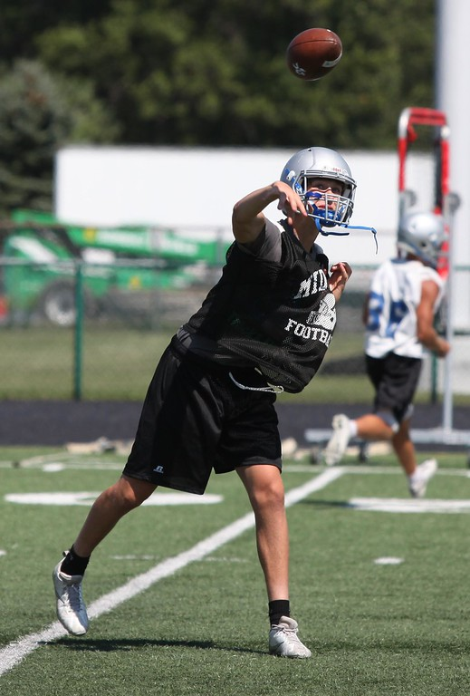 . Randy Meyers - The Morning Journal<br> Midview quarterback Andrew Gooch passes to a receiver during the first day of high school football practice on July 31.