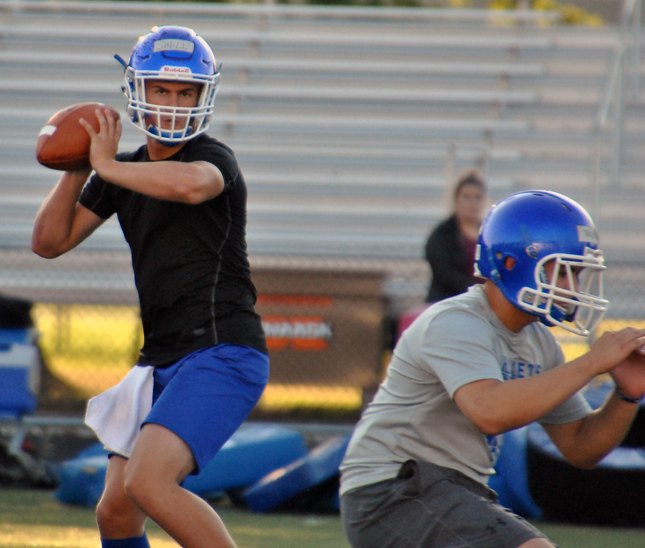 . Jon Behm - The Morning Journal<br> Bay junior quarterback Connor Shell works through his reads during the Rockets\' first official practice of the 2017 season on July 31.
