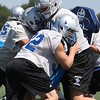 Rrandy Meyers - The Morning Journal<br> Midview's offensive and defensive linemen take part in blocking drills at the first football practice of the season on July 31.