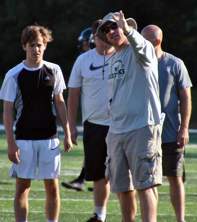 . Jon Behm - The Morning Journal<br> Westlake head coach Jason Hall gives some kicking instructions during practice on July 31.