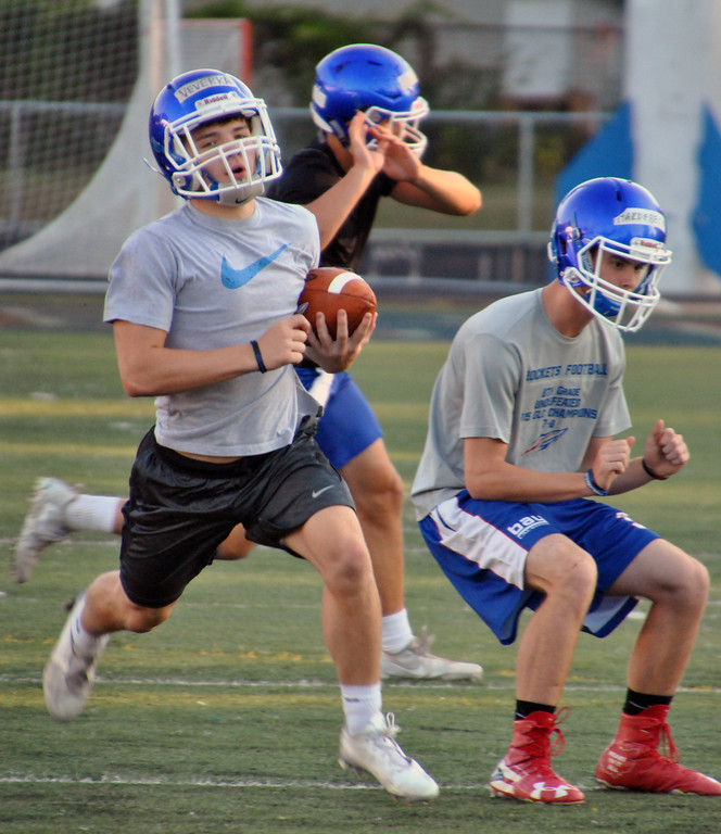 . Jon Behm - The Morning Journal<br> Bay junior Andrew Veverka turns the corner into open space during a drill on July 31.