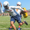 Eric Bonzar—The Morning Journal<br> Titans offensive linebacker and wide receiver Davion Dower runs pad drills, during the first day of practice, July 31, 2017.