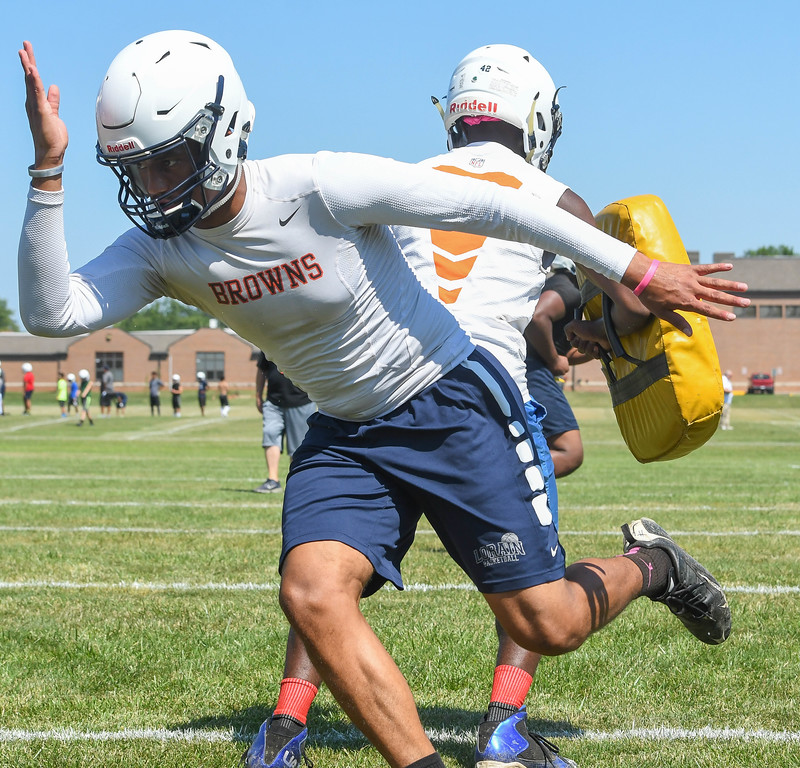 . Eric Bonzar�The Morning Journal<br> Titans offensive linebacker and wide receiver Davion Dower runs pad drills, during the first day of practice, July 31, 2017.