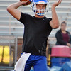 Jon Behm - The Morning Journal<br> Bay junior quarterback Connor Shell winds up for a throw during the first day of high school football practice on July 31.