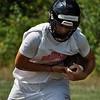 Jon Behm - The Morning Journal<br /> Brookside senior Tim Ackerman keeps his helmet down while making a run on Aug. 1.