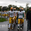 The Morning Journal File<br> The Amherst Comets are led onto the field by seniors Austin Stierhoff (27) and Cameron Jackson (24) to take on Westlake on Oct. 21.