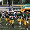 Randy Meyers - The Morning Journal<br /> Christian Velez leads the Amherst Comets onto the field and holds the Fallen Officers Memorial Flag in honor of his father, Trooper Kenny Valez, on Sept. 16. Tooper Valez was killed in the line of duty on Sept. 15.