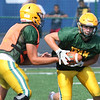 Randy Meyers - The Morning Journal<br> Amherst quarterback Matt Fairchild hands off to Jonathan West during a scrimmage against Lorain on Aug. 11.