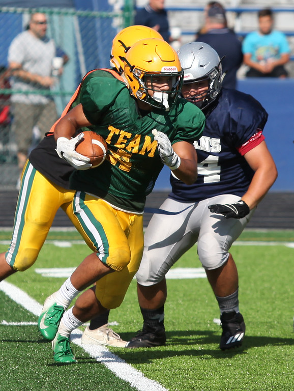 . Randy Meyers - The Morning Journal<br> Amherst running back Khennedy Scagliozzo runs against Lorain during a scrimmage on Aug. 11.