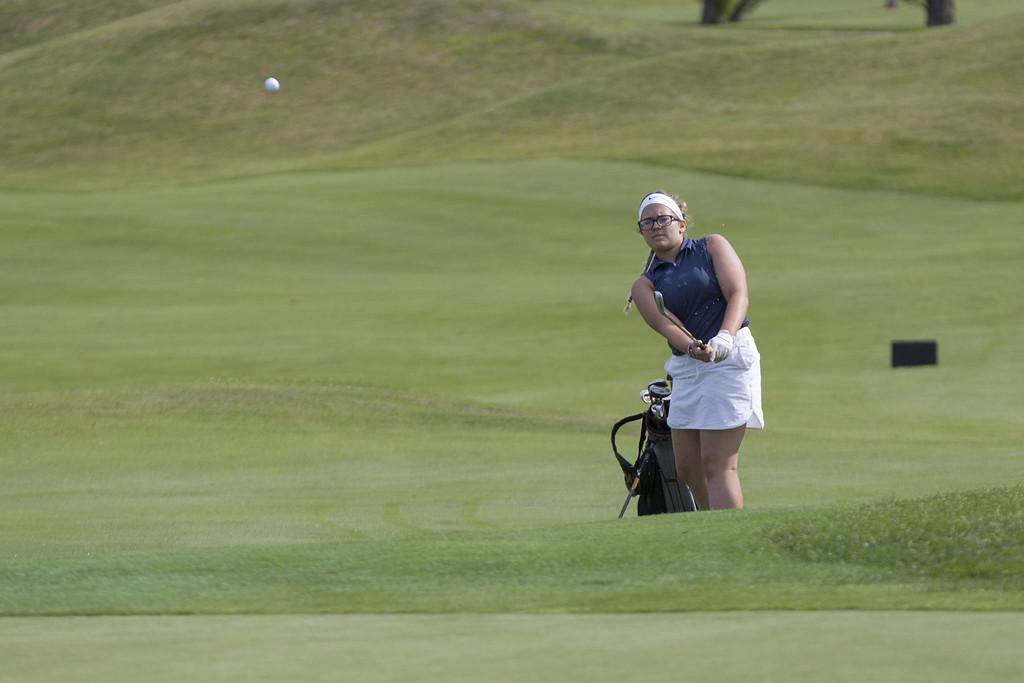 . Jen Forbus - The Morning Journal  Midview\'s Callie Bradley knocks her shot onto the green.
