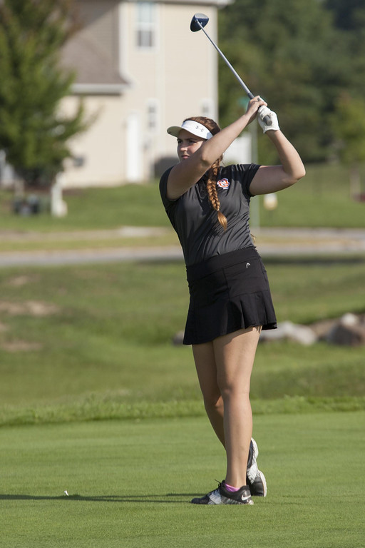 . Jen Forbus - The Morning Journal North Olmsted\'s Lauren Akers tees off on the fourth hole at Gray Hawk during the SWC girls preview.