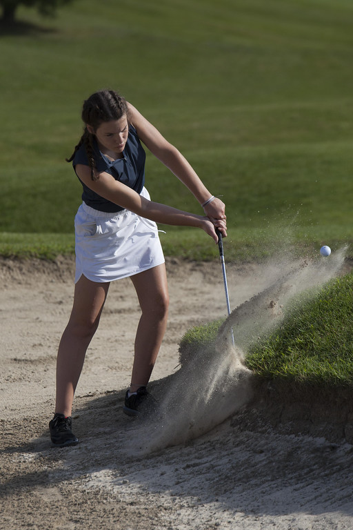 . Jen Forbus - The Morning Journal Riley McCaffrey of Midview works her way out of a sand trap.
