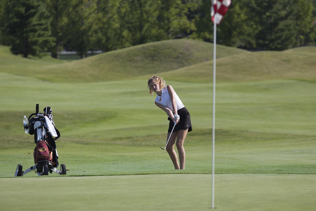 . Jen Forbus - The Morning Journal An Avon Lake golfer chips her shot onto the green.