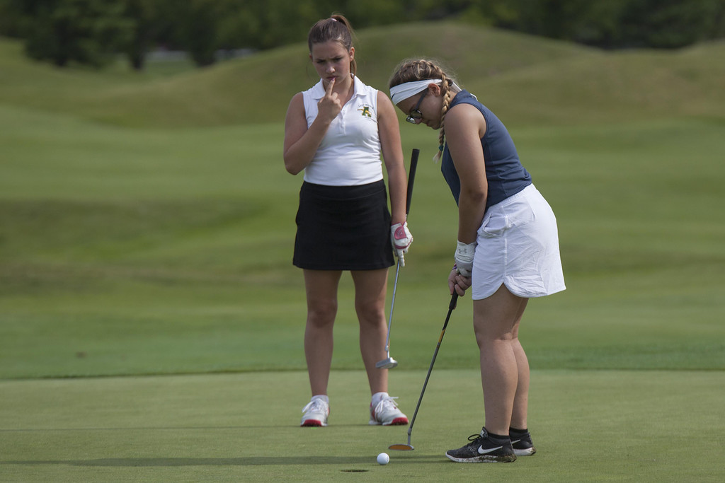 . Jen Forbus - The Morning Journal Midview\'s Callie Bradley putts for the cup at the SWC girls preview.