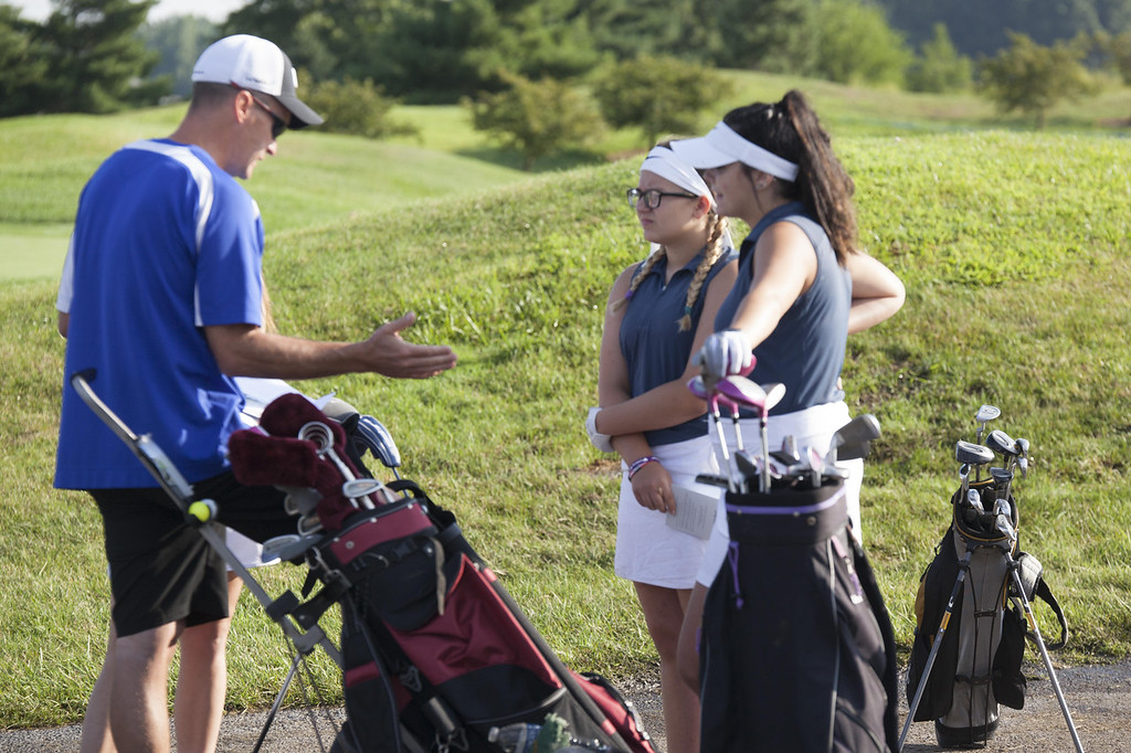 . Jen Forbus - The Morning Journal Midview golfers get some last minutes tips from coach Troy DiFranco.