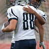 Jen Forbus - The Morning Journal<br> Lorain wide receiver Zach Evans get a hug following his touchdown during a scrimmage against Avon Lake on Aug. 16.