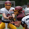 Jen Forbus - The Morning Journal<br> Avon Lake quarterback Jack Mikolich fakes a hand-off to running back Konner Riggs on Aug. 13.