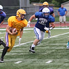 Randy Meyers - The Morning Journal<br> Avon quarterback Ryan Malloy rolls away from the Brunswick defense for a big gain during a scrimmage on Aug. 16.