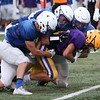Randy Meyers - The Morning Journal<br> Avon wide reciver Dominick Huguley is brought down after a gain by three Brunswick defenders on Aug. 16.