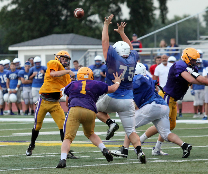 Randy Meyers - The Morning Journal<br> Avon quarterback Ryan Maloy throws over the Brunswick pressure for a touchdown during a scrimmage on Aug. 16.