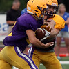 Randy Meyers - The Morning Journal<br> Avon quarterback Ryan Maloy hands off to Nick Perasik against Brunswick during a scrimmage on Aug. 16.