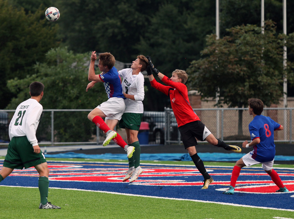 . Randy Meyers - The Morning Journal<br> Bay and Westlake players go up together for a high kick towards the goal during the first half on Aug. 17.