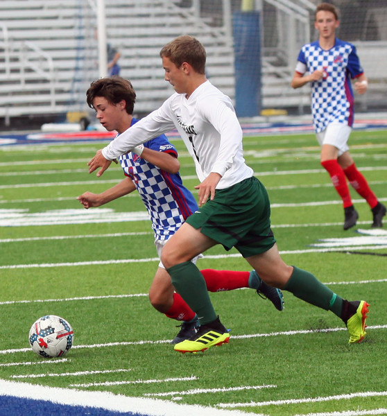 Randy Meyers - The Morning Journal<br> Westlake's Aidan Sharak and Bay's Hayden Coffman run to the ball near the sideline during the first half on Aug. 17.