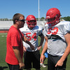 John Kampf - The News-Herald<br /> Perry assistant coach Chris Bezzig goes over blocking schemes with Nick Mason while Noah Kuhn listens in during practice at Alumni Stadium on Aug. 3.