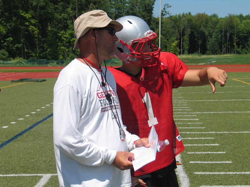 John Kampf - The News-Herald<br /> Geneva head coach Chip Sorber and quarterback Chase Livingston talk about a play during practice at SPIRE in Geneva on Aug. 3.
