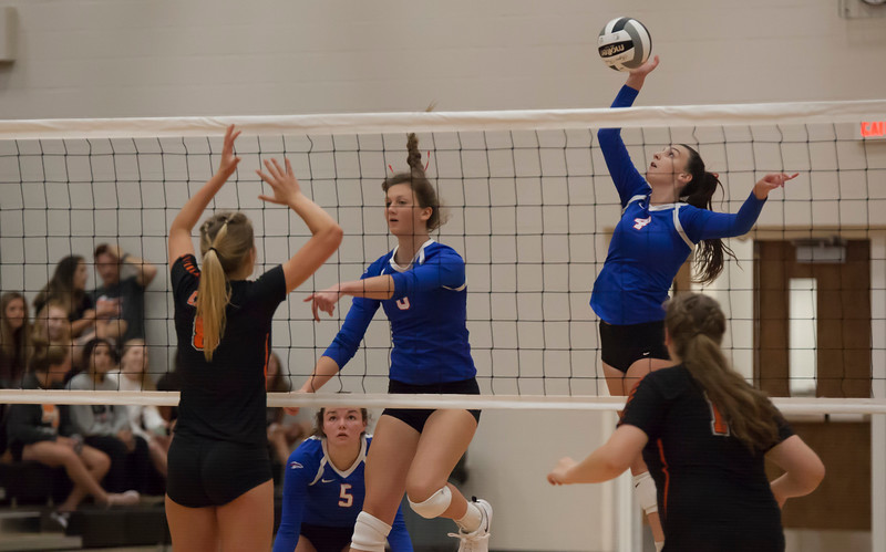 Jen Forbus - The Morning Journal<br> Bay's Maggie McAndrews sends the ball back to the North Olmsted's side of the net on Aug. 18.