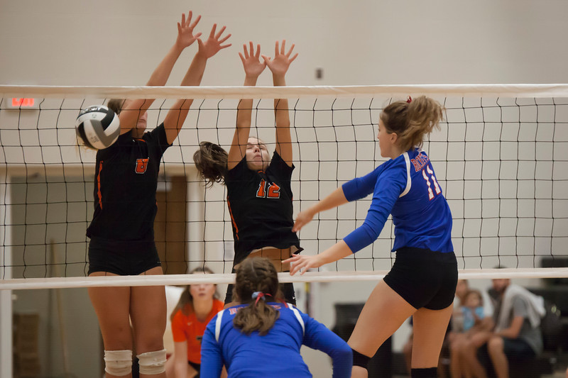 Jen Forbus - The Morning Journal<br> North Olmsted's Zinta Frigic and Jessica Yelsik block a shot from Bay's Lilah Cooper on Aug. 18.