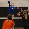 Jen Forbus - The Morning Journal<br> Bay's Maggie McAndrews goes up for a spike against North Olmsted on Aug. 18.