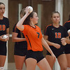 Jen Forbus - The Morning Journal<br> As the North Olmsted players were announced prior to their game against Bay on Aug. 18, they launched small volleyballs into the stands. Sadee Schlund takes aim with hers.